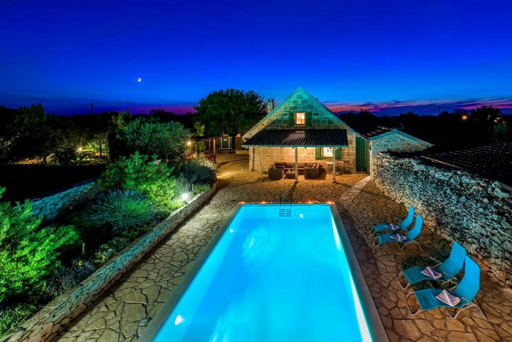"""The swimming pool at or close to Rural house Mudrinic """"Ivini dvori"""""""