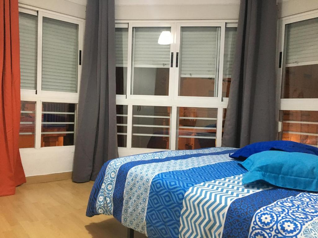 A bed or beds in a room at Appartamento turistico