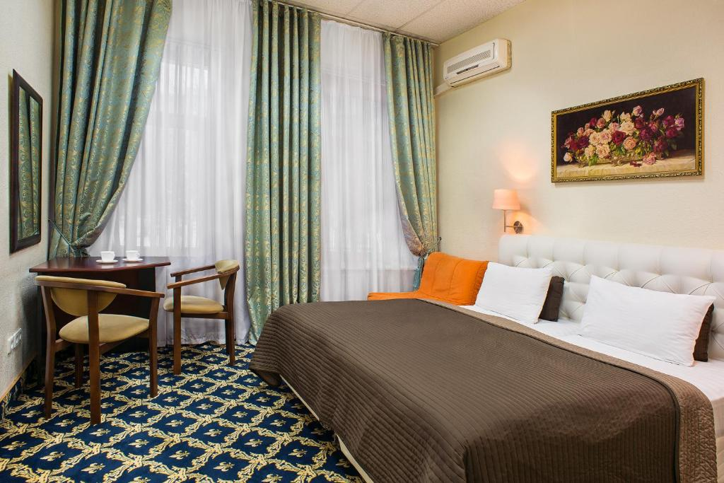 A bed or beds in a room at Basis-M Hotel