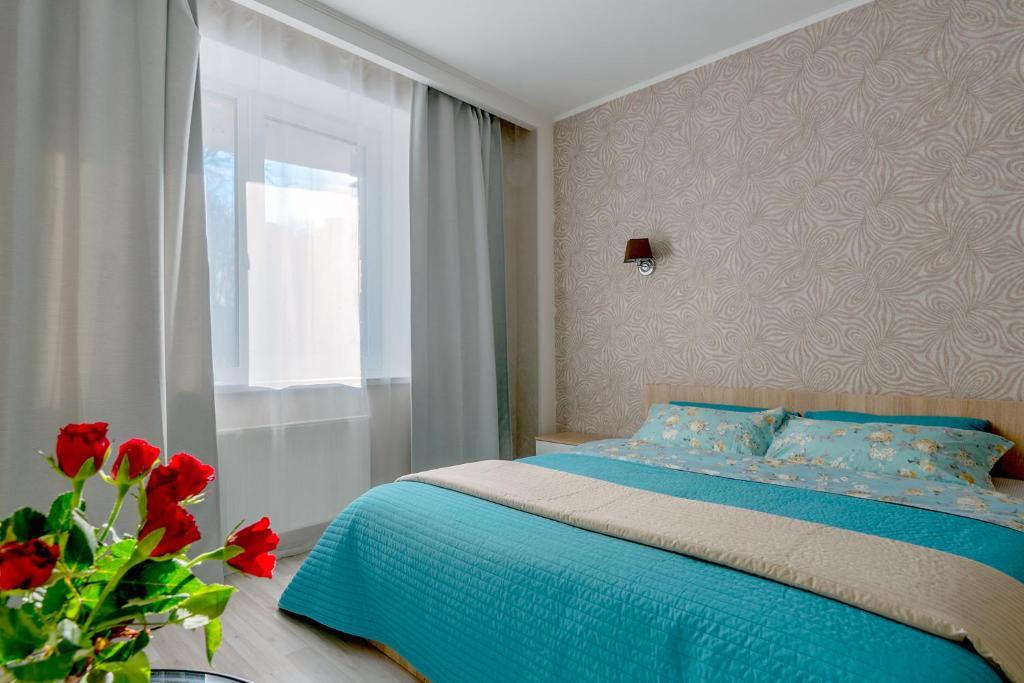 Кровать или кровати в номере Apartments at Yaroslavskiy prospekt