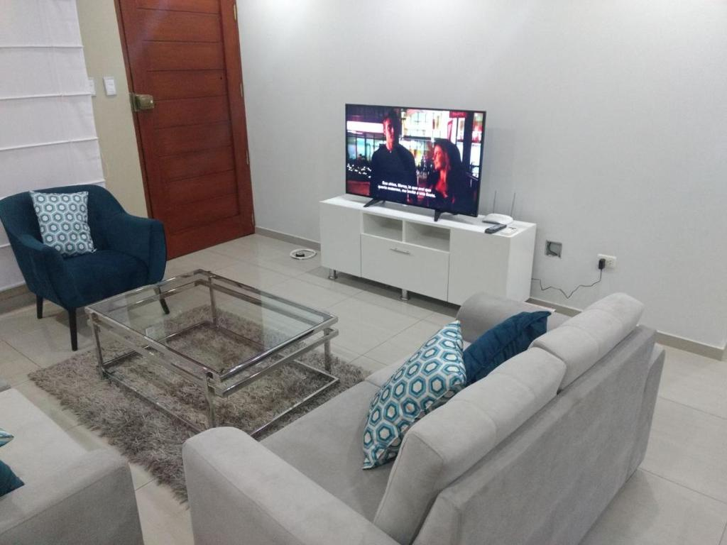 A seating area at Apartamento Ahj