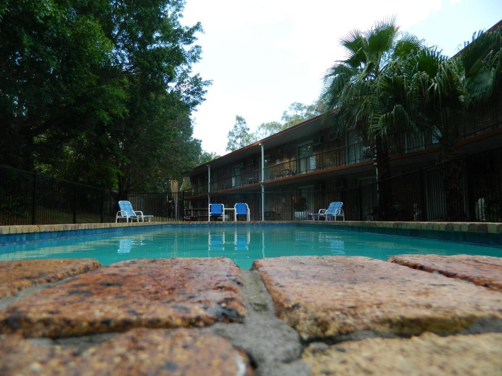 The swimming pool at or near Coomera Motor Inn