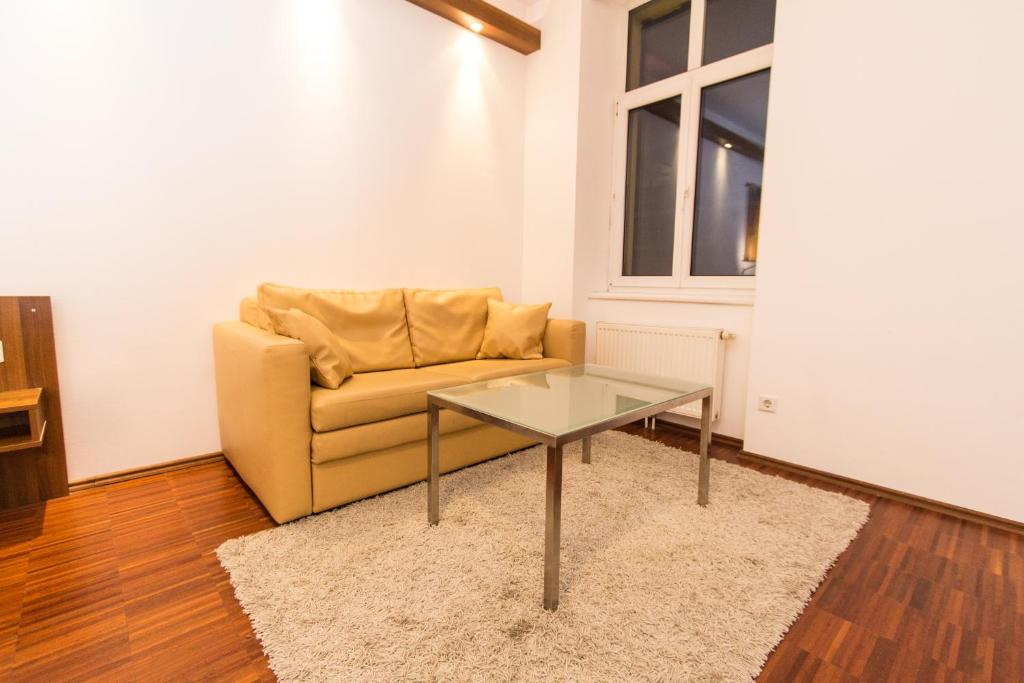 A seating area at Premium Apartment