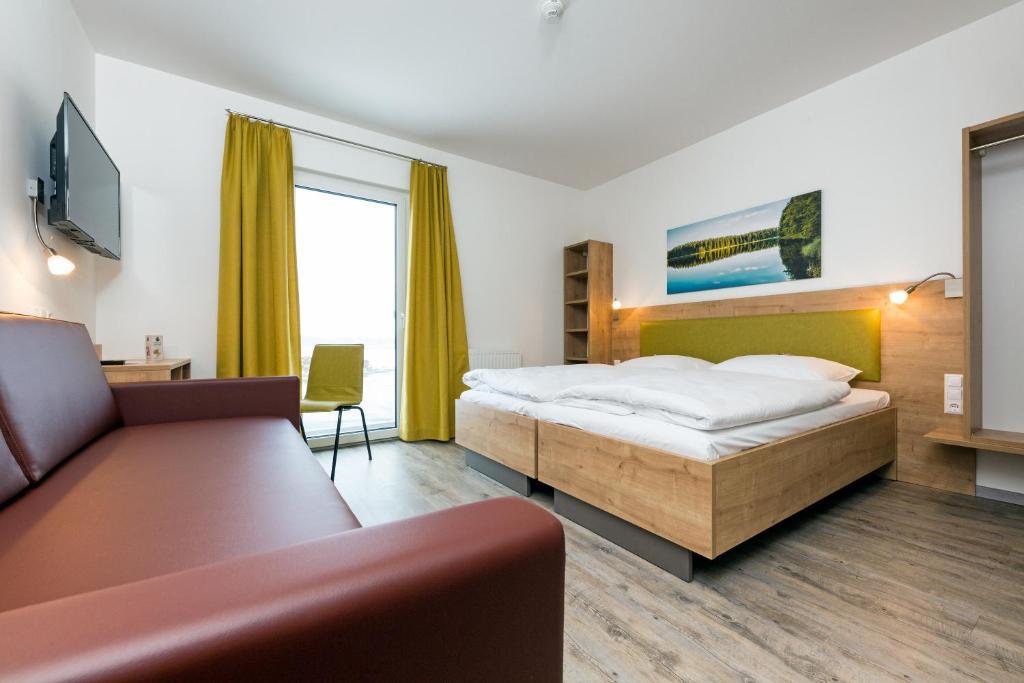 Ein Bett oder Betten in einem Zimmer der Unterkunft Cleverhotel