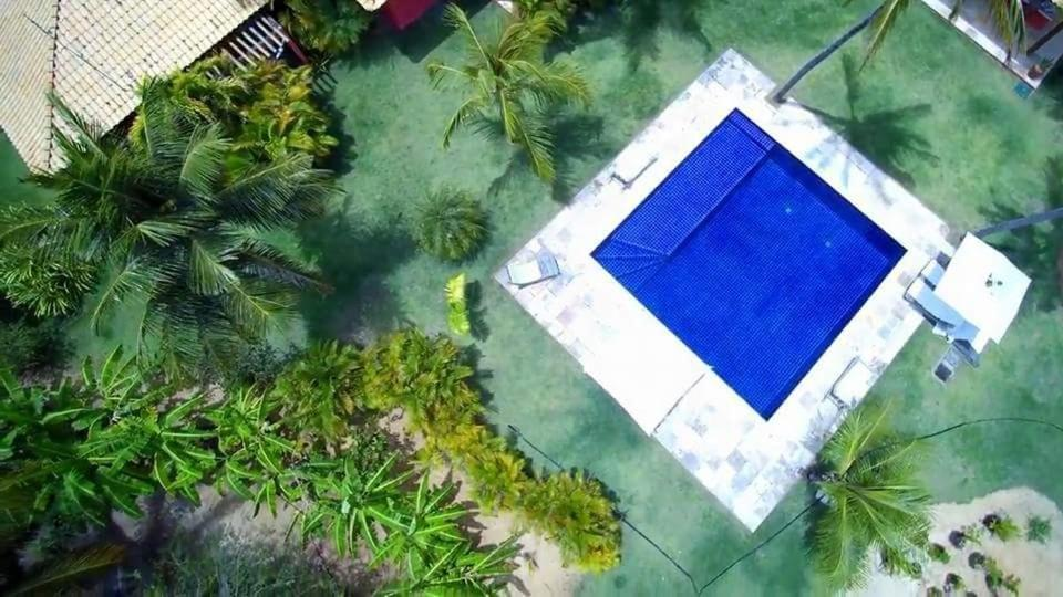 A view of the pool at Villa Ruby em Maracajaú or nearby