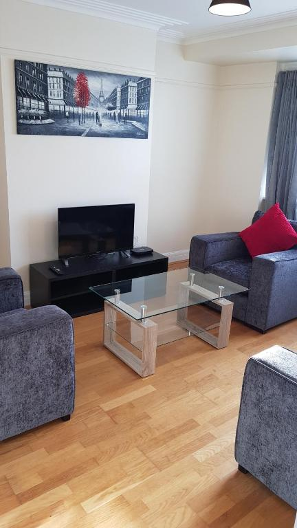 A television and/or entertainment center at Elegant and spacious 2 bedroom