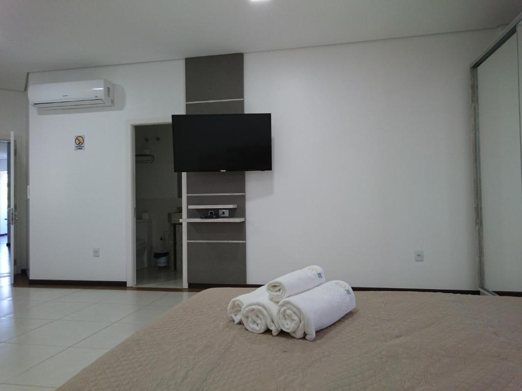 A television and/or entertainment center at Raios de Sol Missioneiro