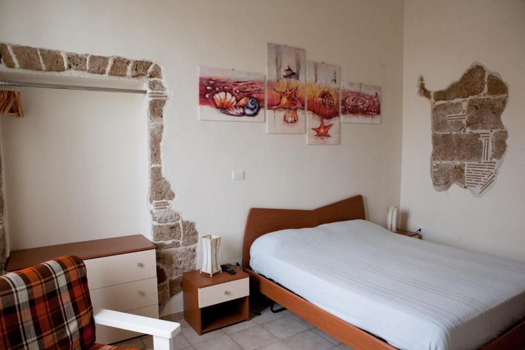 A bed or beds in a room at Poseidon B&B