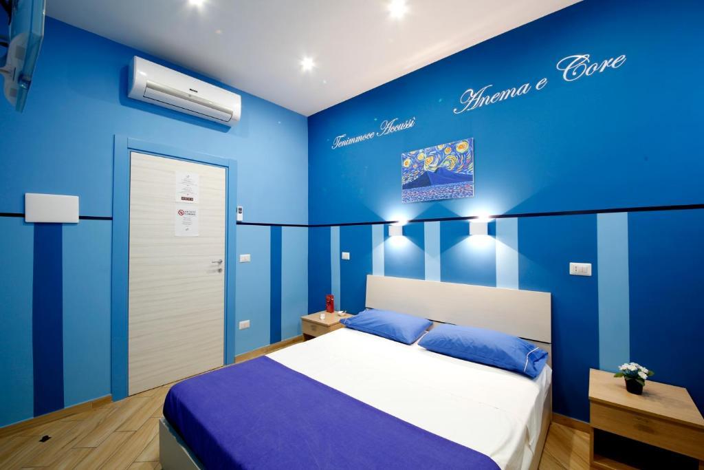 Un ou plusieurs lits dans un hébergement de l'établissement B&B Residenza Alba
