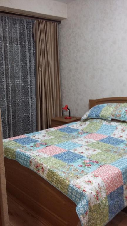 A bed or beds in a room at Apartments Zoya