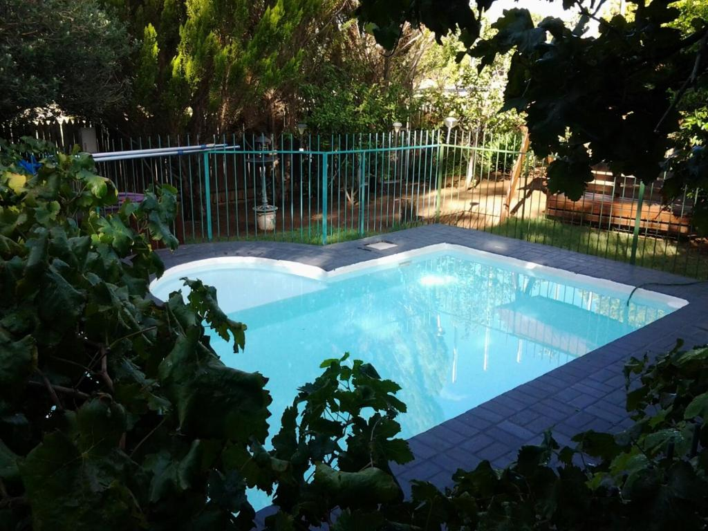 The swimming pool at or near SunRose Group of Guesthouses