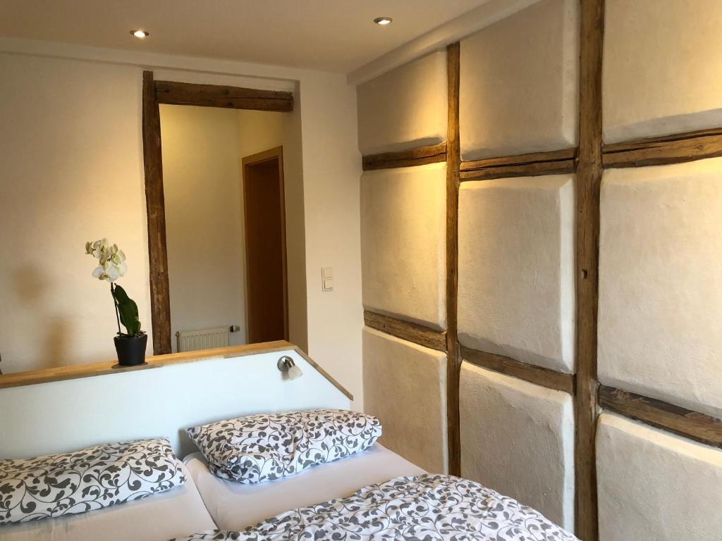 Ein Bett oder Betten in einem Zimmer der Unterkunft Stella Apartments am Erfurter Dom
