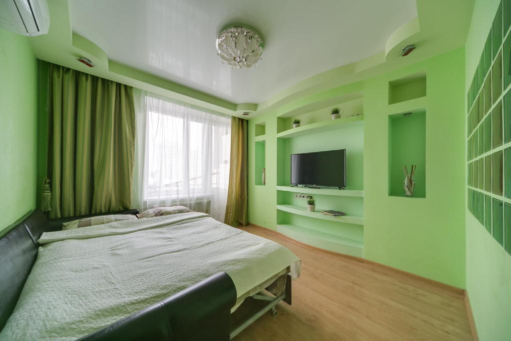 Телевизор и/или развлекательный центр в Yaroslavskaya Vigvam24