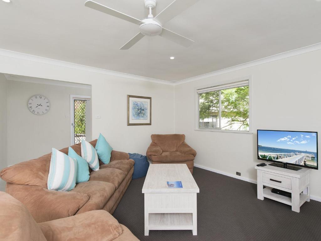 A seating area at Essendene Road, Box Beach Retreat, 29