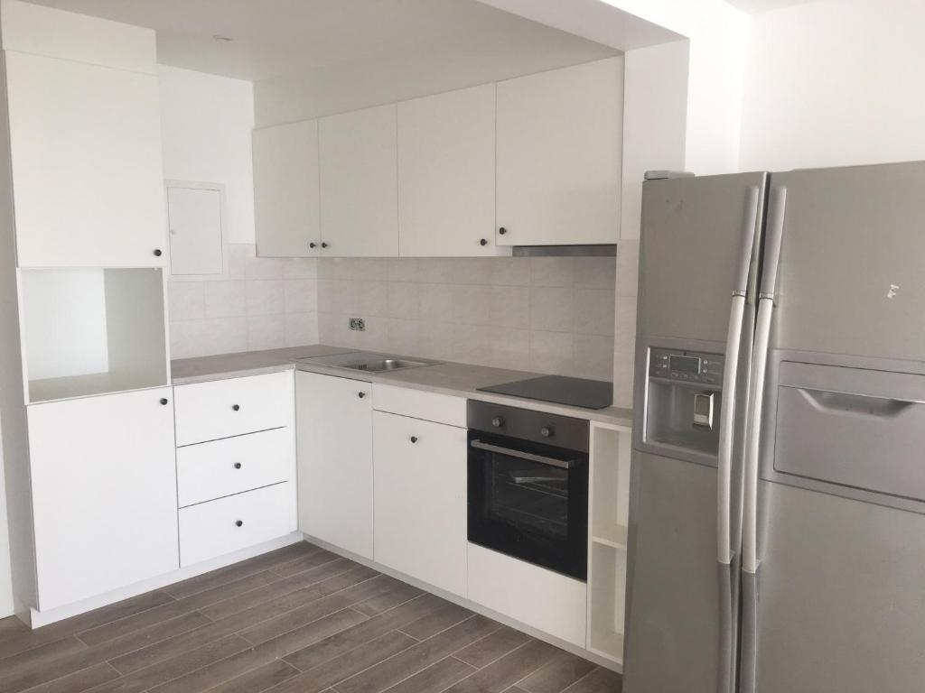 A kitchen or kitchenette at Apartment Havenzicht