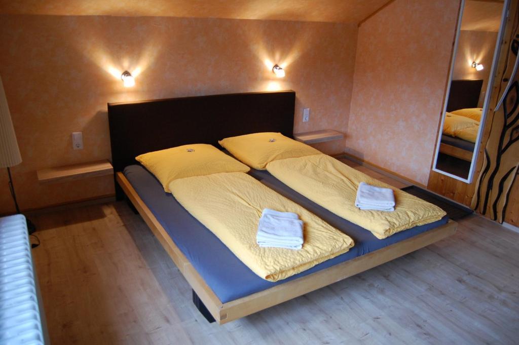 Ein Bett oder Betten in einem Zimmer der Unterkunft BnB-Regelsbach