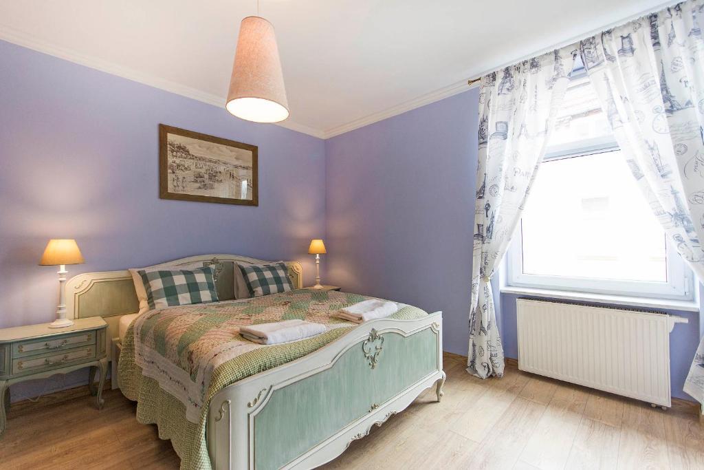 Łóżko lub łóżka w pokoju w obiekcie Bay of Sopot