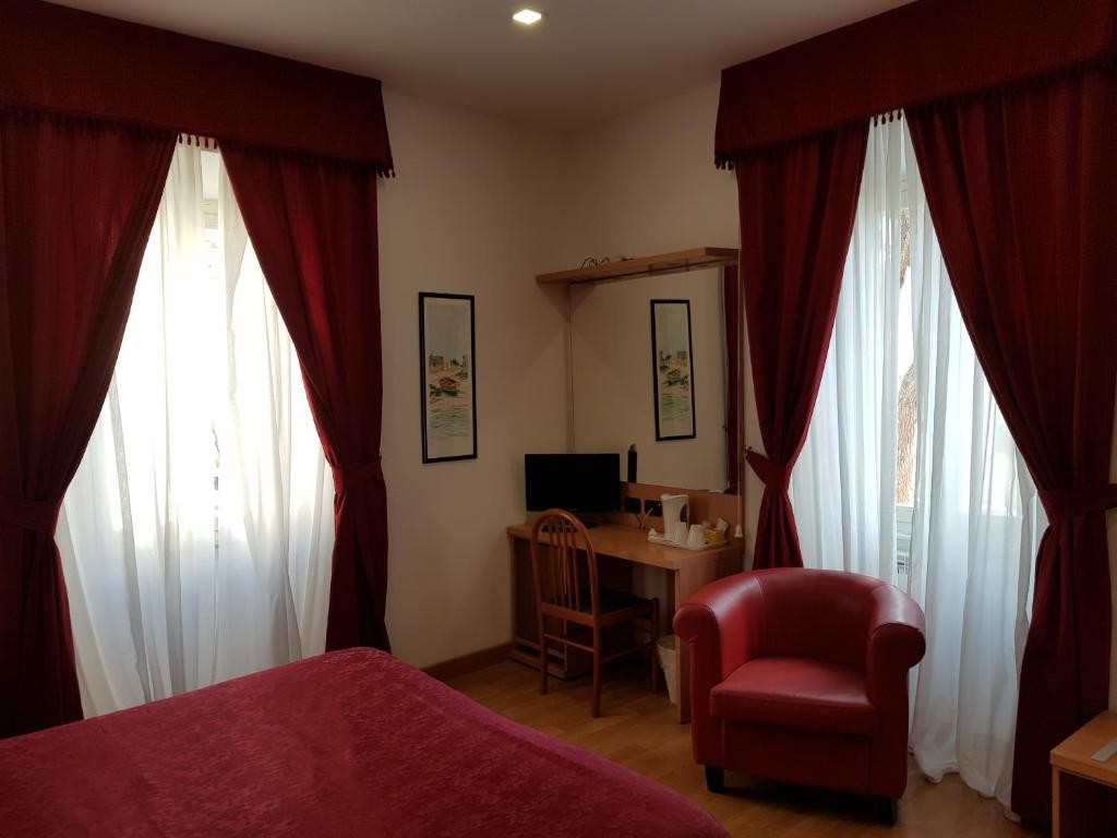 Ein Sitzbereich in der Unterkunft Hotel L'Isola