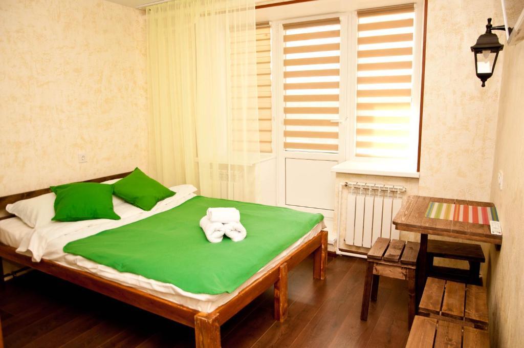 """Кровать или кровати в номере """"Соня"""" мини-гостиница"""