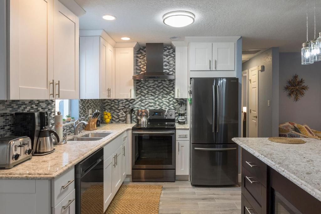 A kitchen or kitchenette at Salt and Sand Vacation Cottages