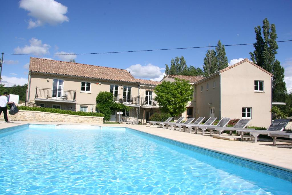 The swimming pool at or near Moulin Mariman