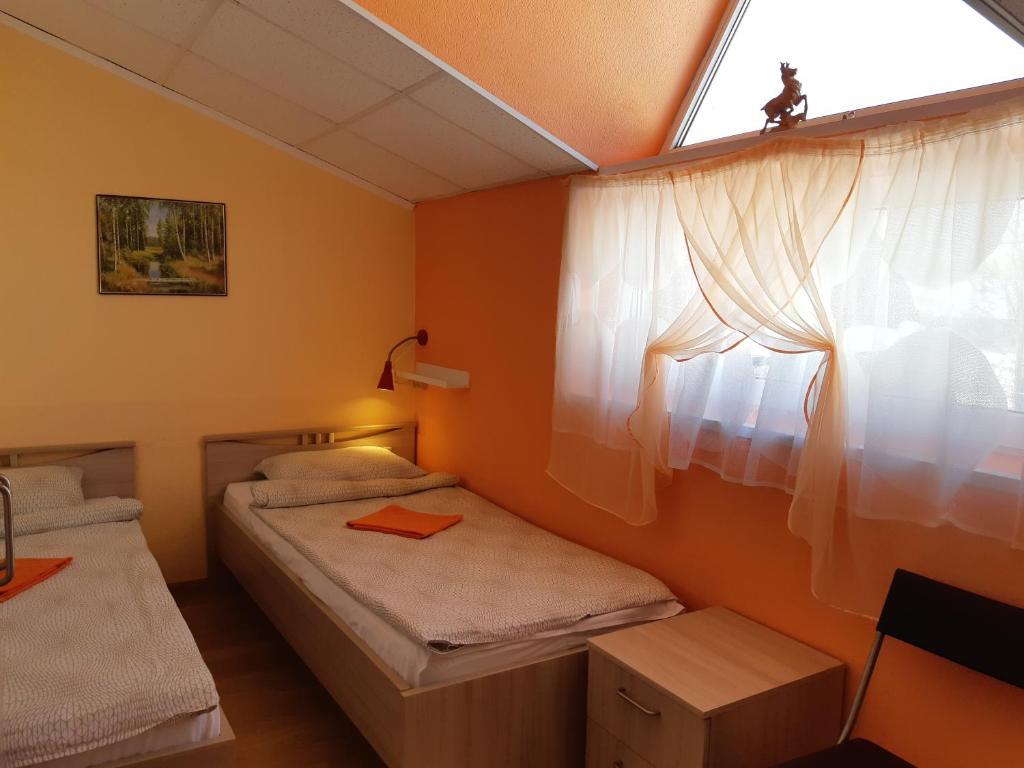 Кровать или кровати в номере Хостел Ярви