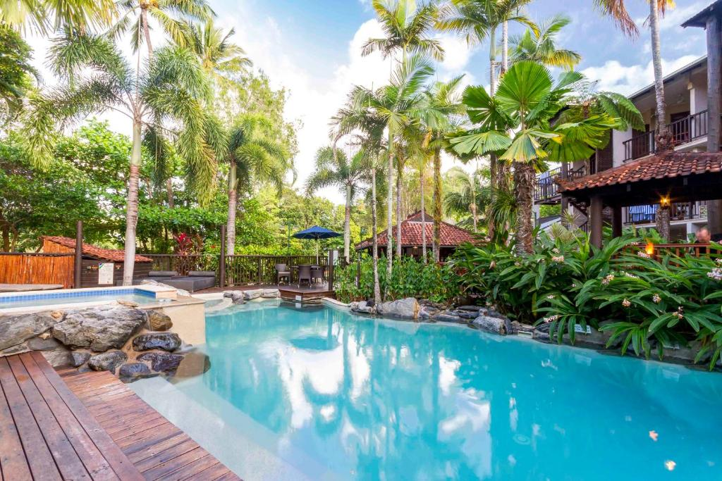 The swimming pool at or near Hibiscus Resort And Spa Book Here With The Onsite Reception Open Daily