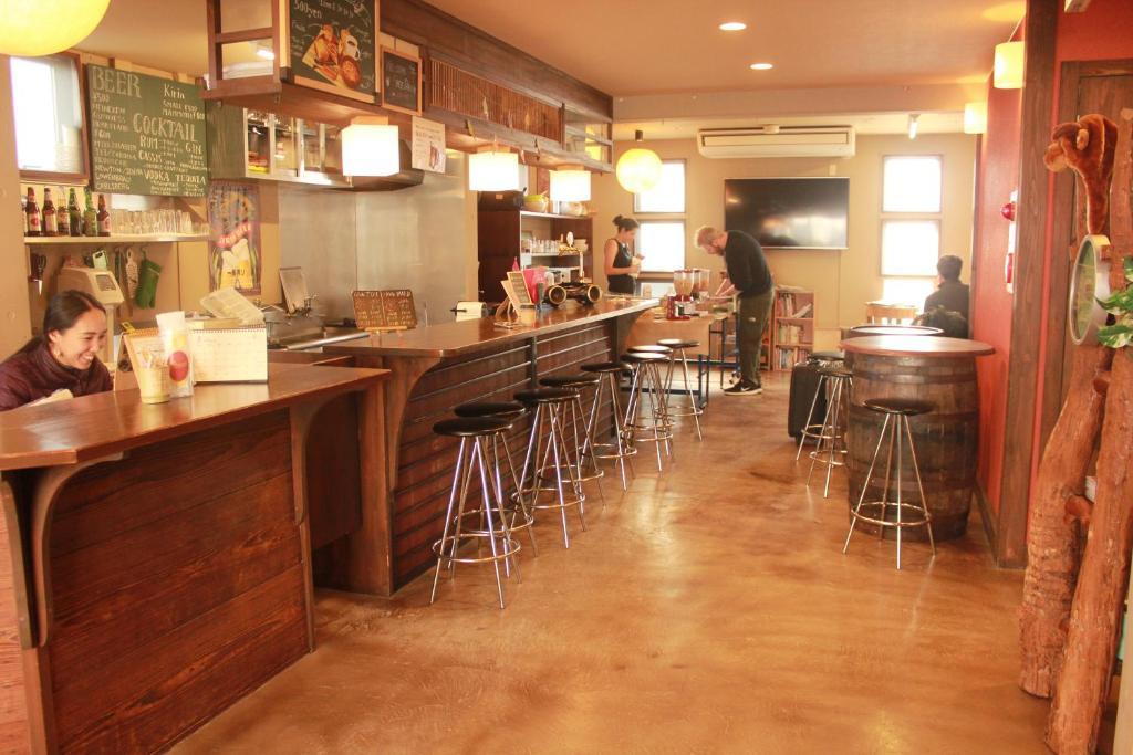 Backpackers Miyajimaにあるレストランまたは飲食店