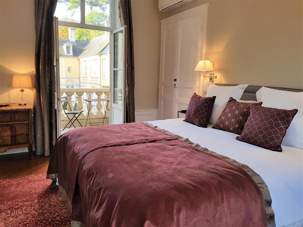 Een bed of bedden in een kamer bij Le Tardif, Noble Guesthouse