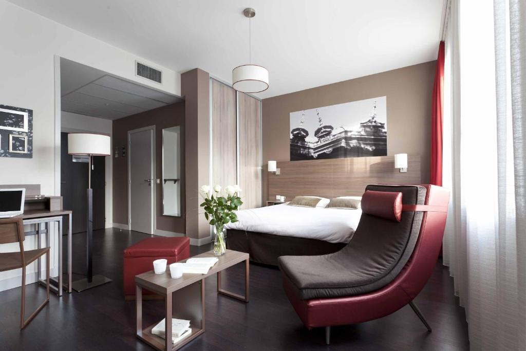 Гостиная зона в City Lofthotel Saint-Etienne