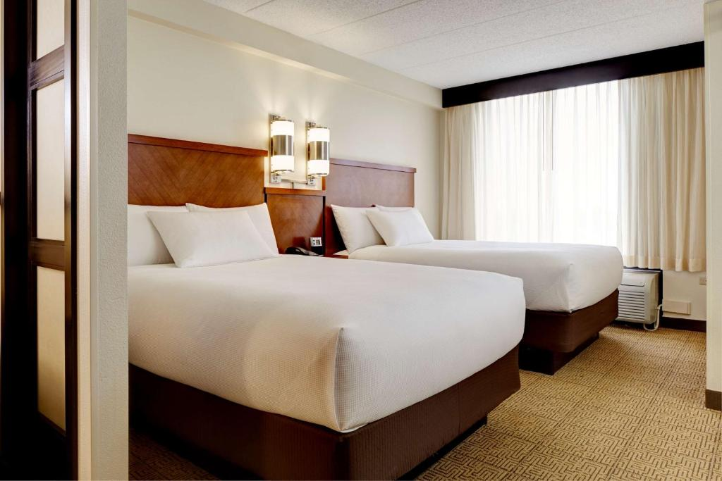 A bed or beds in a room at Hyatt Place Princeton