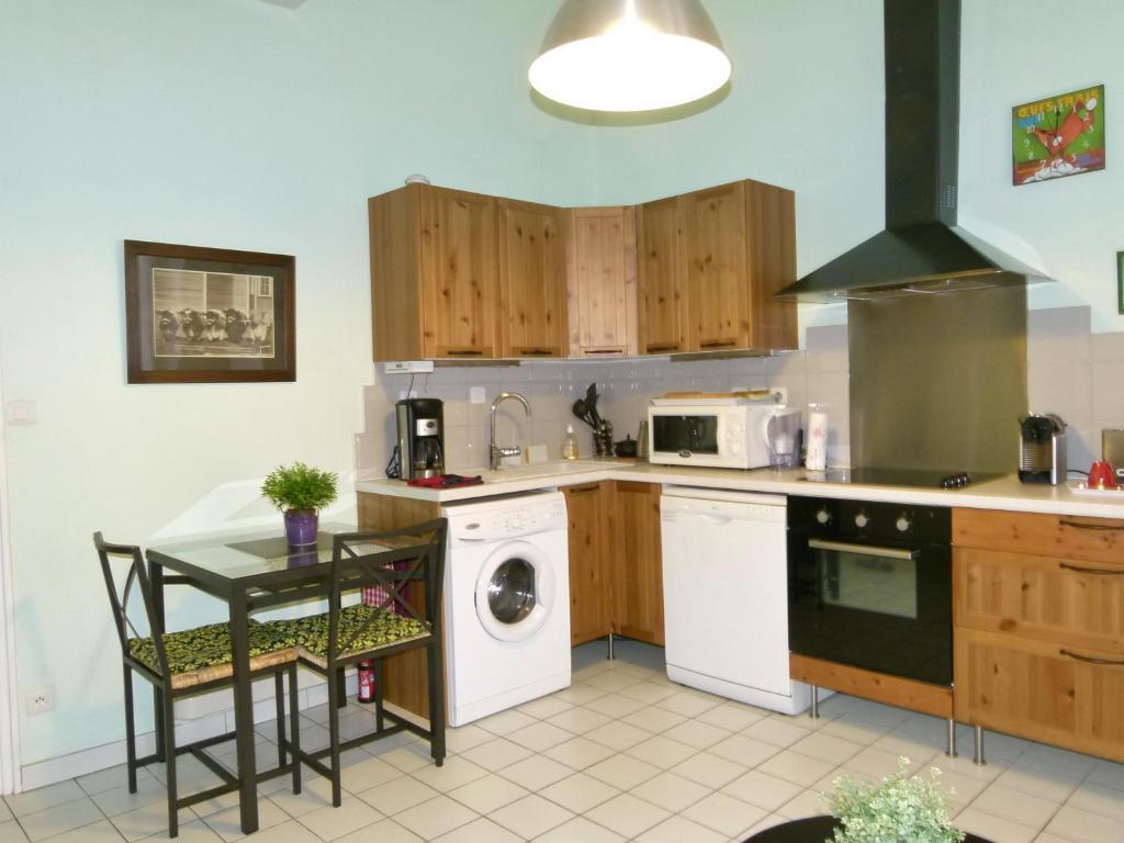 A kitchen or kitchenette at Perrache Sainte Blandine