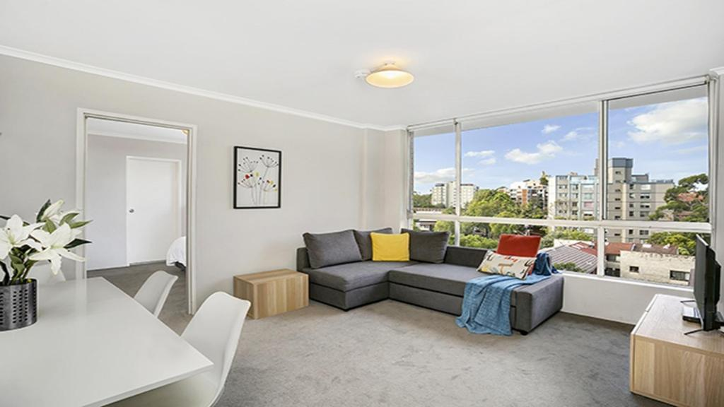 A seating area at Light Filled Apartment Moments from the CBD - RAND3
