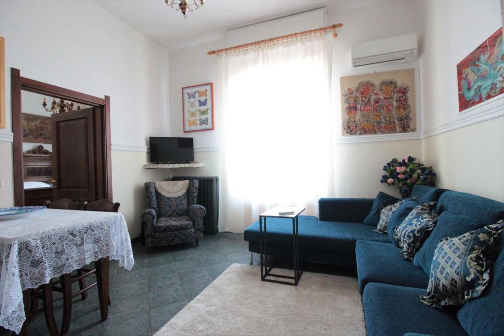 A seating area at Villino la Magnolia Blue
