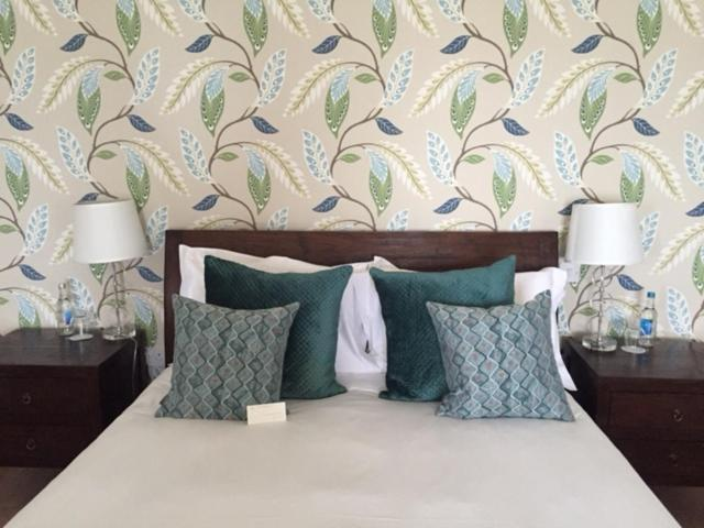 A bed or beds in a room at The Hambrough