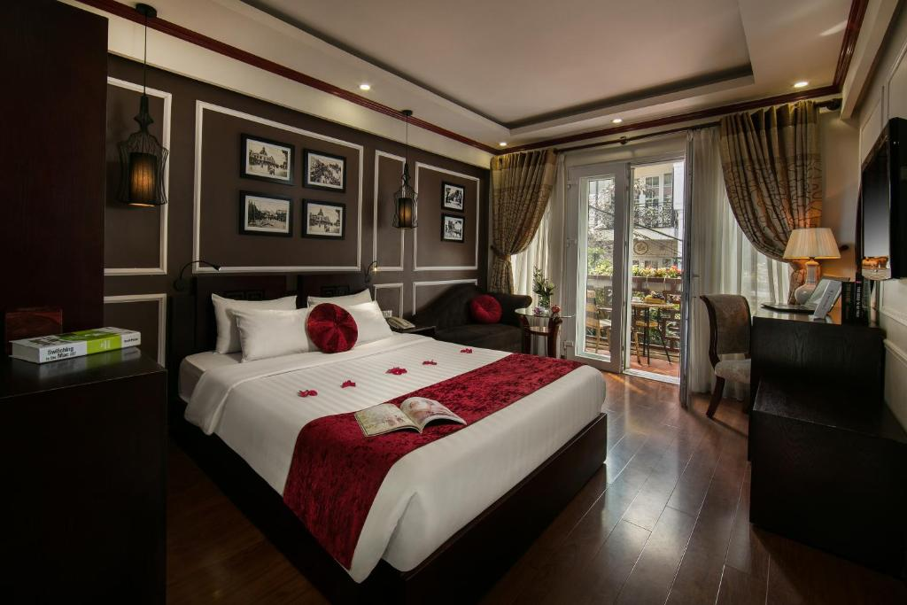 A bed or beds in a room at Hanoi Paradise hotel & Spa