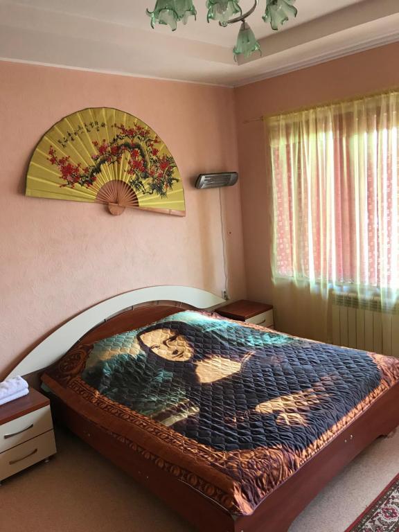 Кровать или кровати в номере Алексей Отель
