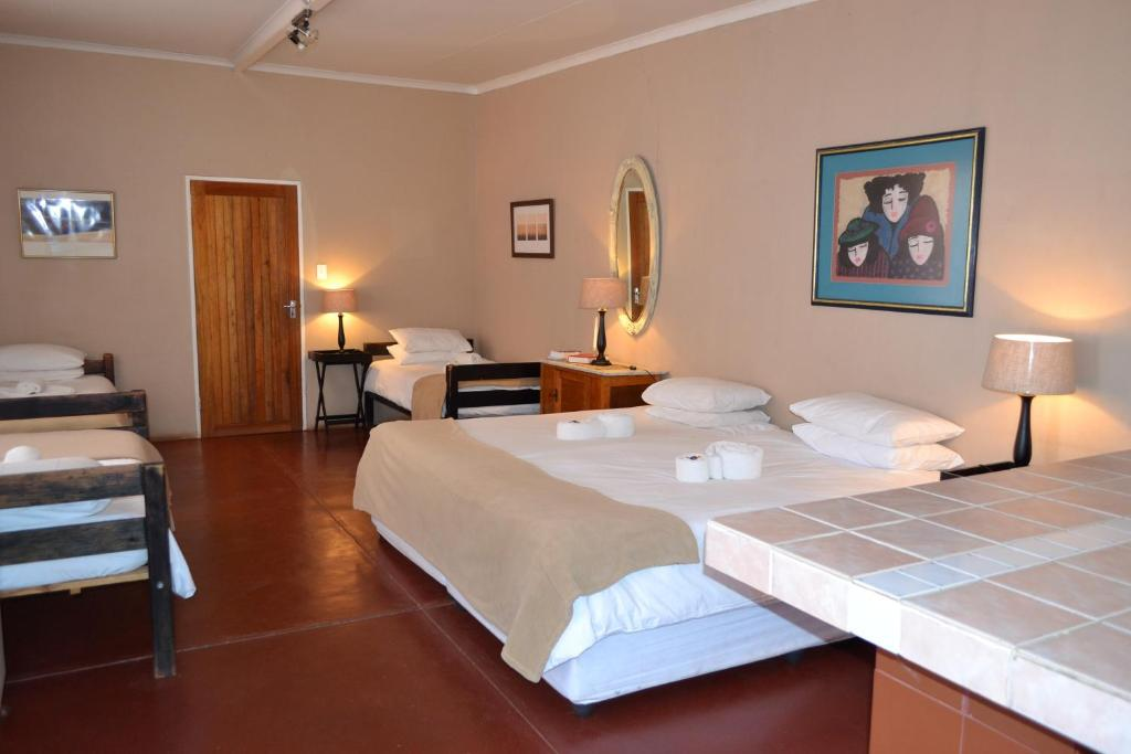 A bed or beds in a room at Savanna Guest Farm