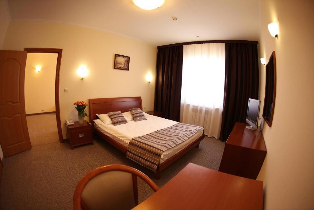 Кровать или кровати в номере Рубин