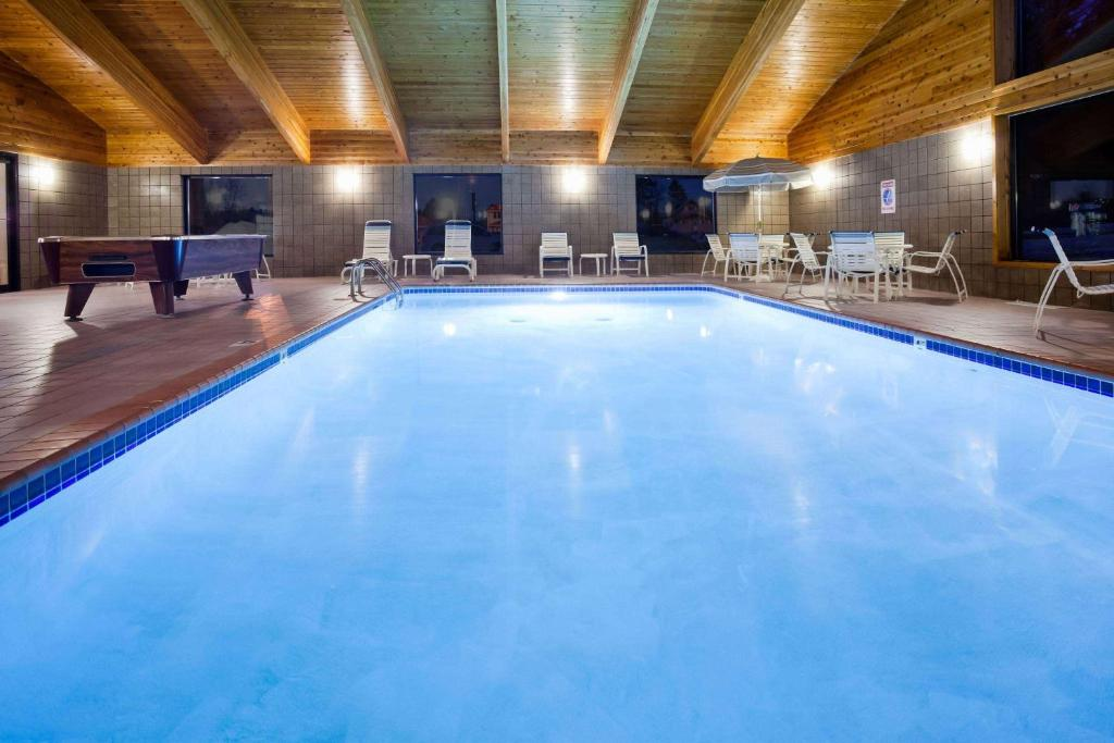 The swimming pool at or near AmericInn by Wyndham Ironwood