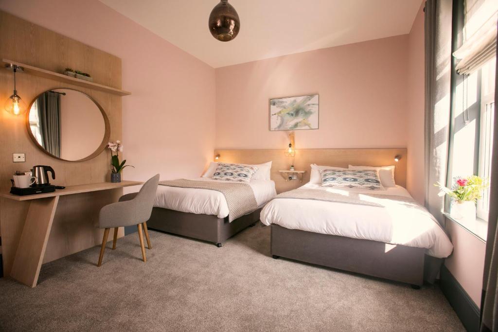 Cama o camas de una habitación en The Fullerton Arms
