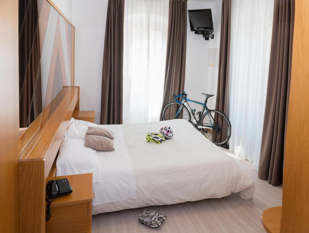 Кровать или кровати в номере Albergo Ristorante Da Neni
