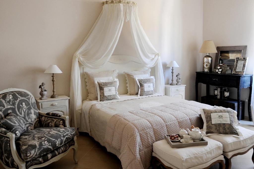 Letto o letti in una camera di B&B La Garçonniere