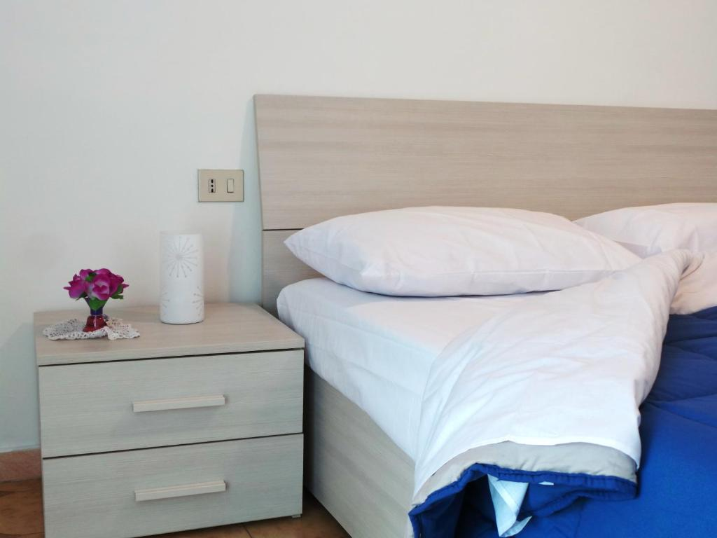 A bed or beds in a room at Meta Italy San Siro
