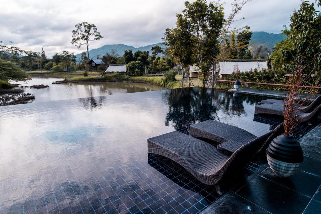 The swimming pool at or near Lala Mukha Tented Resort Khao Yai