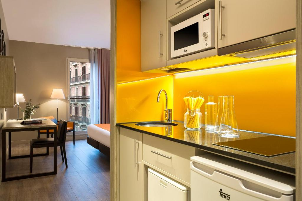 A kitchen or kitchenette at Citadines Ramblas Barcelona