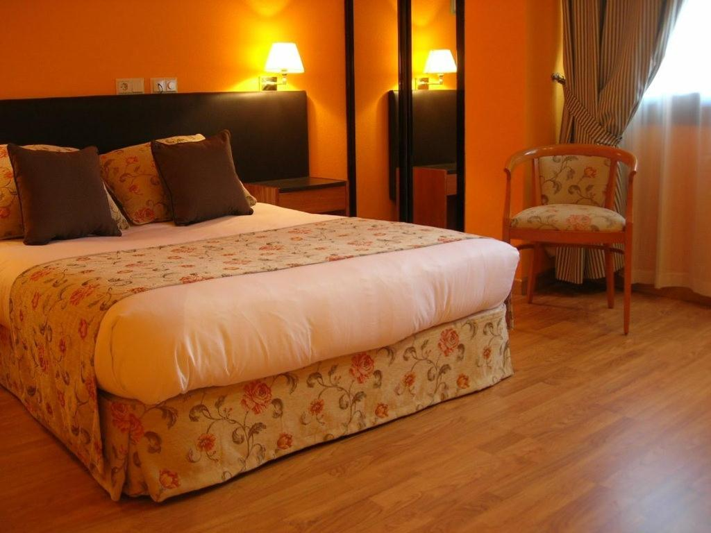 A bed or beds in a room at Torre Hogar