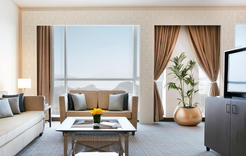 A seating area at Royal M Hotel Fujairah Mall