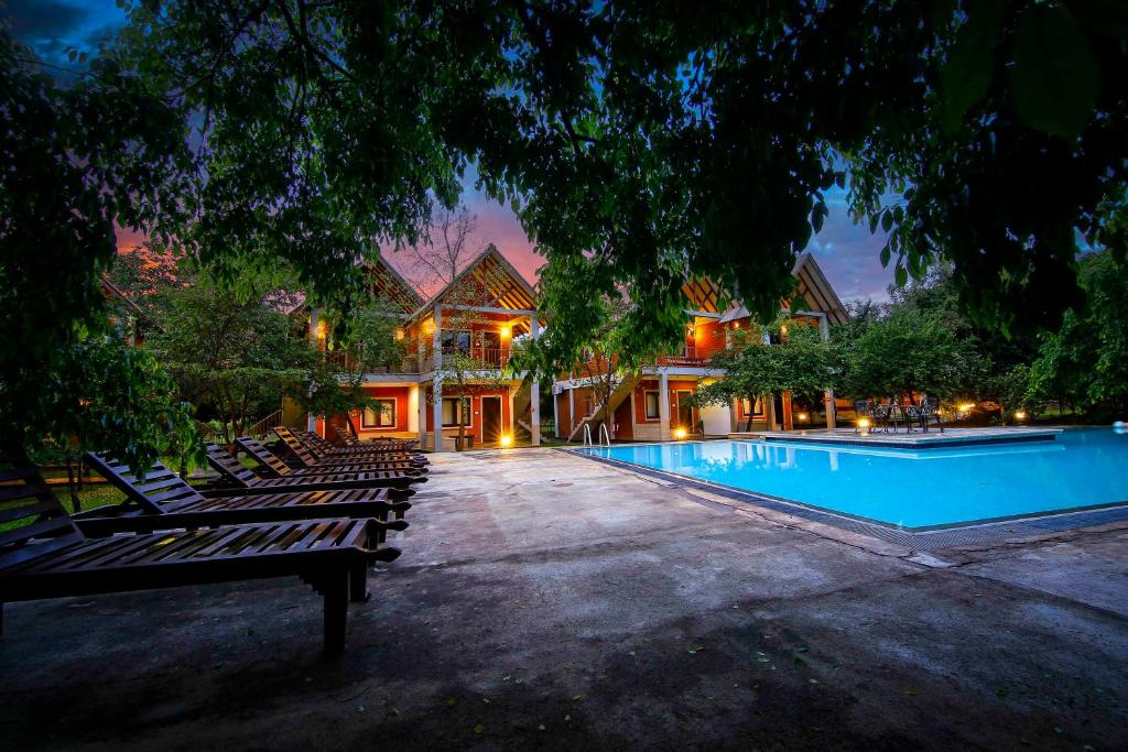 The swimming pool at or near Elephas Resort & Spa