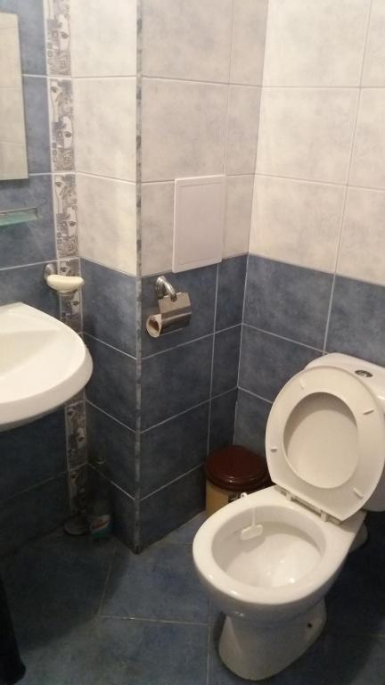 A bathroom at Private Apartment in Sunny House family